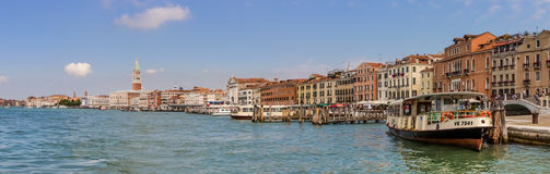 Venice, Italy - June 28, 2014: Panorama of Venice - view from Grand canal on quay, water buses and buildings Royalty Free Stock Photos