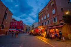 VENICE, ITALY - JUNE 18, 2015: Restaurants street in Venice, tourists looking the best place. Sky almost blue Stock Images