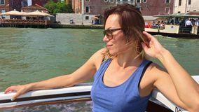 Venice, Italy - June 19, 2016: A smiling woman with sunglasses floating in the vaporetto, Venice stock video footage