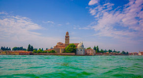 VENICE, ITALY - JUNE 18, 2015: Spectacular view of Venice city, nice green water and tower at the end with various Royalty Free Stock Images