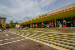 VENICE, ITALY - JUNE 18, 2015: Tourists and passengers waitting outside of Venice airport, crowded airport in summer. Big stairs out royalty free stock photo