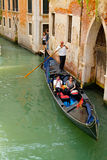 Gondolier on a gondola Stock Images