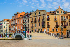Venice, Italy - June 28, 2014: Tourists walking on a summer morning on the streets of Venice Stock Image