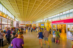 VENICE, ITALY - JUNE 18, 2015: Unidentified people making their lasts shops in Venetian airport, crowded building inside.  royalty free stock photos