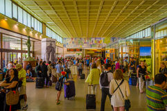 VENICE, ITALY - JUNE 18, 2015: Venetian airport of the building inside, people carrying their bags and walking all Royalty Free Stock Image
