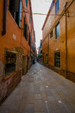 VENICE, ITALY - JUNE 18, 2015: Venice narrow streets in a pinturesque neigborhood, people shopping on the sides and Stock Photography