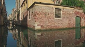 VENICE, ITALY - JUNE 19 2016: View of small canal in Venice stock footage