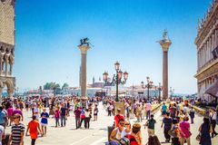 View of St. Mark`s Square, columns of St. Mark and St. Theodore in Venice stock photos