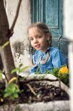 Venice, Italy. A little mischievous girl in a blue dress plays in an old Venetian courtyard royalty free stock images