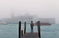 Venice italy man standing on the pier near the Grand Canal, cine Stock Image