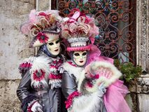 Free Venice, Italy - March 1, 2019 Two Person Dressed With Typical Venice Costumes Pose For A Photo Royalty Free Stock Images - 141254419