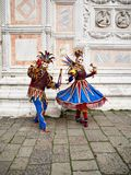 Venice, Italy - March 1, 2019 A couple is dressed with an Arlequin costume stock images