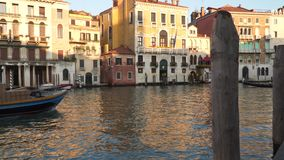 Gondolas and boats sailing along the canal in Venice stock footage