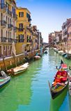VENICE, ITALY - MARCH 28, 2015: Ships and boats on the Grand Canal, Veni. Each year 20 million tourists visit Venice Stock Photos