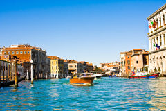 VENICE, ITALY - MARCH 28, 2015: Ships and boats with tourists on the Grand Canal, Veni. Each year 20 million tourists visit Venice Royalty Free Stock Photos