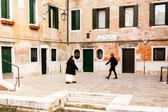 Venice, Italy - March 11, 2012: Two women going on ancient street in Venice stock photo