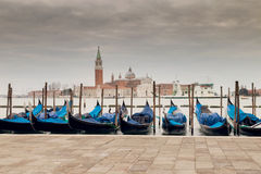 VENICE, ITALY - MARCH 17, 2016. Urban canal and boats on it, on a gloomy day in Venice, Italy. Vintage filter. Royalty Free Stock Photos