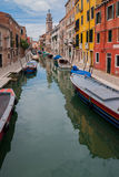 VENICE, ITALY - MAY 16, 2010: Boats at a channel in Venice, Italy Stock Photography