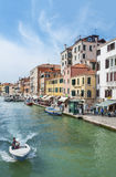 Venice, Italy. MAY 06 : Canal with crowd of tourist on May 06, 2014 in Venice. Venice is very famous tourist destination of Italy. Many tourists visiting all Stock Photos