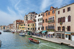 Venice, Italy. MAY 06 : Canal with crowd of tourist on May 06, 2014 in Venice. Venice is very famous tourist destination of Italy. Many tourists visiting all Stock Image
