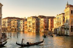 Gondolas floats on the Grand Canal in Venice at sunset Royalty Free Stock Photo