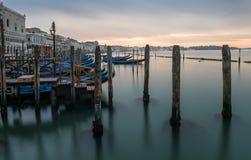Venice, Italy - 20 May 2105: Gondolas moored on the lagoon. Earl Royalty Free Stock Photo