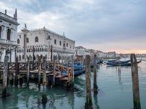 Venice, Italy - 20 May 2105: Gondolas moored on the lagoon. Earl Royalty Free Stock Photos