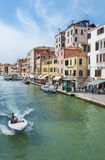 Venice, Italy. May 6, 2014 : Grand Canal with crowd of tourist in . Venice is very famous tourist destination of Italy and Many tourists visiting all year Stock Photos