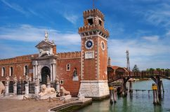 Venice, Italy - 07 May 2018: Historic shipyard, Arsenal, gate and the channel. Venice, Italy. The gate is richly royalty free stock photo