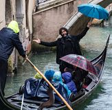 Man serenades gondola riders in Venice Stock Photos