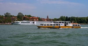 Venice, Italy - 07 May 2018: River Cruise Ship RIVER COUNTESS by Croisi Europe in Venice. The ship is moored at the pier. Of Venice. In the foreground is a stock photos