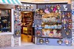 VENICE, ITALY - MAY, 2017: shop full of traditional masks and souvenirs in a small stree. During the Carnival people wear masks to. Conceal their identity royalty free stock image