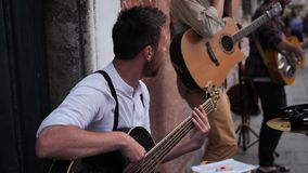 Street musicians in Venice playing guitars stock video footage