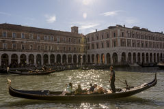 Venice, Italy. may 16, 2016: Tourist on a Gondola tour making pictures Stock Images