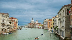 VENICE, ITALY - May 24, 2016: Venice Grand Canal time-lapse with dense shipping transport, moving clouds and Basilica stock video footage