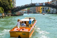 Water taxi with tourists sails along the Grand Canal, Venice Royalty Free Stock Image