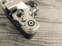 VENICE, ITALY - MAY 13, 2017: A Zenit EM is a vintage film camer. A made in URSS, lying over a dated wooden background Royalty Free Stock Image