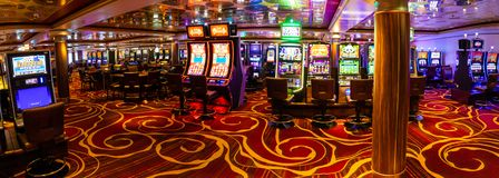 Venice, Italy - 14.10.2018: Modern empty casino hall with game machines in cruise ship Norwegian Star royalty free stock image