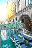 Venice. Italy. Narrow street the channel with the bridge and gondolas Stock Photography