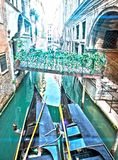 Venice. Italy. Narrow street the channel with the bridge and gondolas Royalty Free Stock Photos