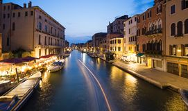 Venice in Italy / Night view of the river canal and traditional venetian architecture Stock Image