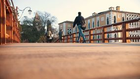 Venice, Italy - November 13, 2018. -People walking on the bridge. Italia. Sunset. Venice, Italy - November 13, 2018. -People walking on the bridge Italia stock footage