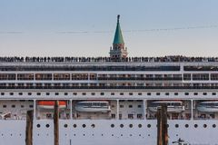 VENICE, ITALY - OCTOBER 07, 2017:  big cruise ship and  part of San Giorgio Maggiore Tower Bell on the background royalty free stock images