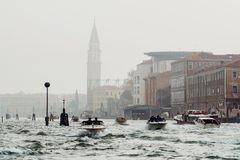 VENICE, ITALY - OCTOBER 6 , 2017: Boats in the Venetian lagoon, architecture in the background Royalty Free Stock Images