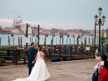 VENICE, ITALY - OCTOBER 8 , 2017: bride and groom in Piazza San Marco. VENICE, ITALY - OCTOBER 8, 2017: bride and groom in Piazza San Marco Royalty Free Stock Images