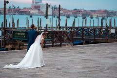 VENICE, ITALY - OCTOBER 8 , 2017: bride and groom in Piazza San Marco. VENICE, ITALY - OCTOBER 8, 2017: bride and groom in Piazza San Marco Royalty Free Stock Image