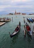 Gondolas and San Giorgio Maggiore islannd in Venice, Italy royalty free stock image