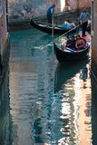 VENICE, ITALY - OCTOBER 7 , 2017: Gondolier floats on the narrow channel in Venice, Italy. VENICE, ITALY - OCTOBER 7 , 2017: Gondolier floats on the narrow Royalty Free Stock Images
