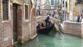 VENICE, ITALY - OCTOBER, 2017: Majestic canals in Venice, Venice, Italy. Gondola in a canal in Venezia Italy. Venice is stock footage