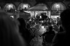 Venice, Italy - October 04: Musicians play for tourists at night on the Piazza San Marco on October 04, 2017 in Venice royalty free stock photos